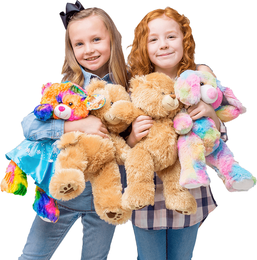 Two girls happily hugging their teddy bears